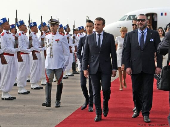Morocco's King Mohammed VI and French President Emmanuel Macron review the honour guard in Rabat