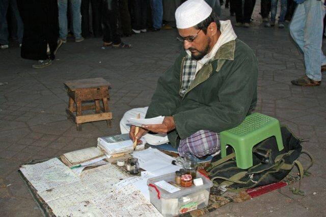 Marokkanischlehrer auf dem Djemaa el Fna